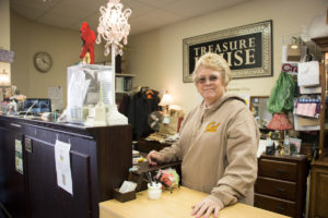 Manager Reenie Meyer at the register